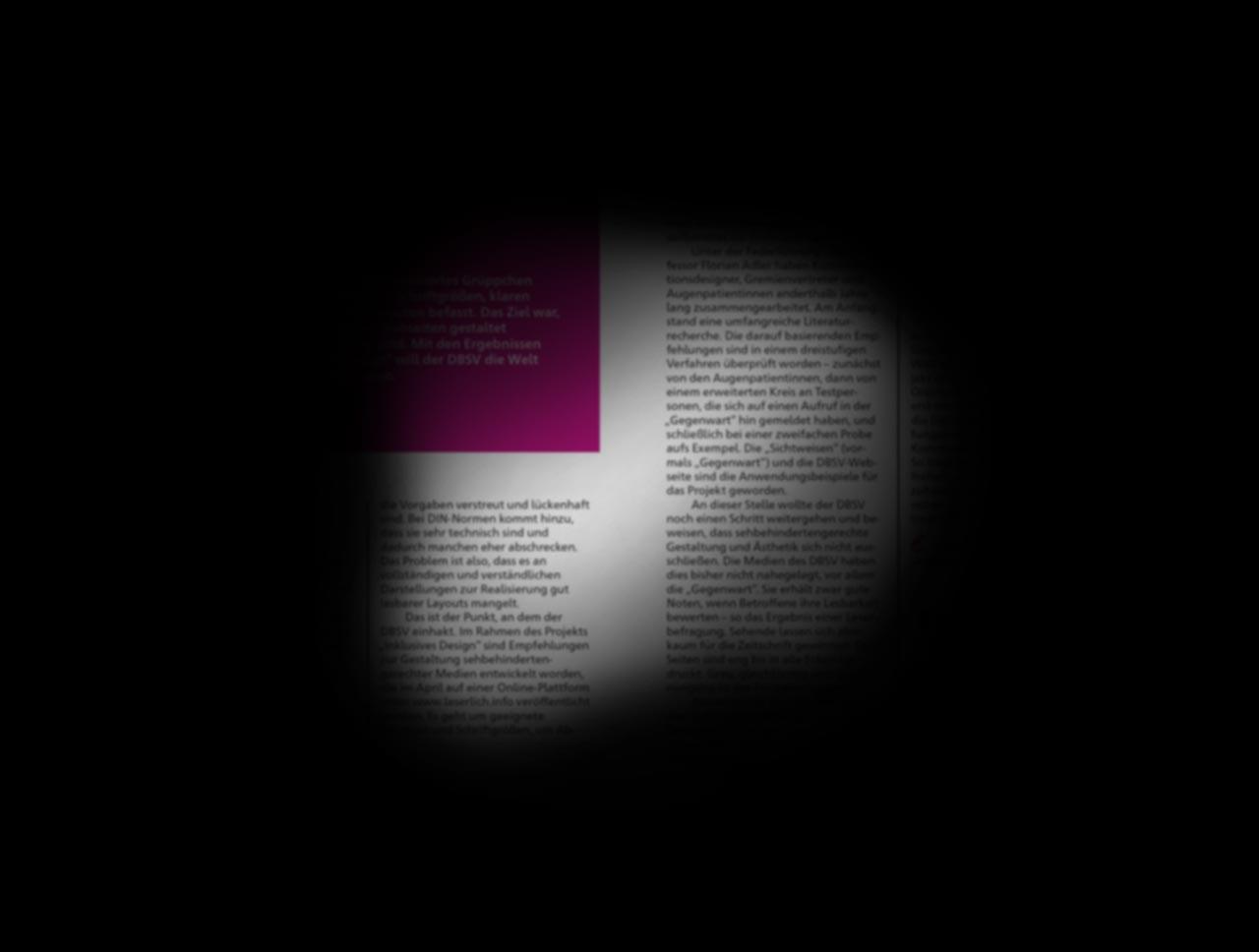 Eine Doppelseite der Zeitschrift »Sichtweisen«. Der größte Teil ist schwarz abgedeckt, nur in der Mitte wird durch eine rundliche Form circa ein Drittel der Doppelseite freigegeben. Der sichtbare Teil ist leicht unscharf.